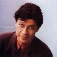 """Robbie Robertson was born (1943) in Toronto, Ontario.  He is a Canadian singer-songwriter, and guitarist. He is best known for his membership as the guitarist and primary songwriter within The Band. The Band has been inducted into the Rock and Roll Hall of Fame and the Canadian Music Hall of Fame. As a songwriter he wrote such classics as """"The Night They Drove Old Dixie Down"""", """"Broken Arrow"""" and """"Somewhere Down the Crazy River"""" http://img.noiset.com/images/artist/robbie-robertson-cd-418.jpeg"""