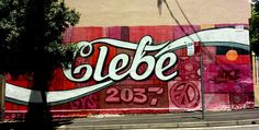 "Coca-Cola themed ""Glebe"" pop art graffiti on the corner of Wentworth and Mitchell Streets, Glebe."