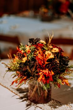 These used bright fall colors, beautiful sunflowers and cute wooden boxes.  Plus incorporated the groom's whiskey bottle collection! | Echelon Florist | Smoky Mountain Wedding | National Park Wedding | Fall Wedding | Spence Cabin Ceremony | Appalachian Clubhouse Reception | Derek Halkett Photography | Absolute Wedding Perfection
