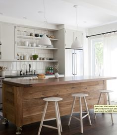 Love the recycled timber used for this island bench and the pendant lights and bar stools