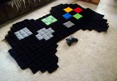 Giant 8 Bit Xbox Controller Rug by harmonden on Etsy Etsy shop Harmonden sells crochet rugs featuring characters from popular video games like Super Mario Bros.mon, The Legend of Zelda, Megaman, and Minecraft. The rugs are available to pu. 8 Bit Crochet, Crochet Pixel, Crochet Rugs, Blanket Crochet, Crochet Squares, Crochet Granny, Crochet Gifts, Granny Squares, Crochet Geek