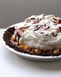 Chocolate appears 3 times in this black-bottom pie: The crust is made of chocolate wafers, the filling is rum-flavored ganache topped with macadamia nuts, and the whipped cream topping is swirled with more chocolate.
