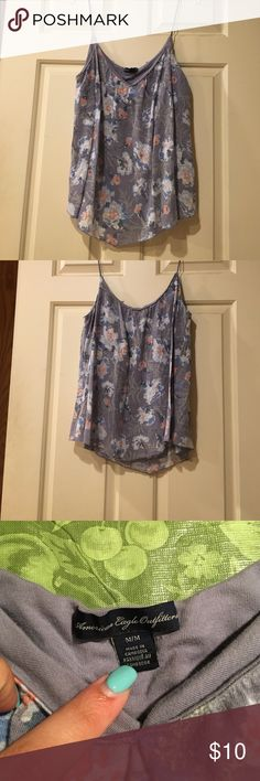Floral Cami top Floral top with thin straps. Includes an inner lining like camisoles. Colors are light and dark blue, pink, yellow, white, and gray. This shirt is also listed in a different color scheme. Any questions contact me! American Eagle Outfitters Tops Camisoles