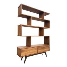 a towering mid century modern style wall shelving unitmade of solid and walnut