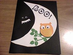 Owl sticker against cut out moon, & monster eyes in the dark!