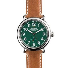 The Runwell 41mm brown leather watch with green face features a stainless steel case along with a Swiss quality quartz Argonite 1069 movement, which is hand-assembled in Detroit from nearly four-dozen Swiss made parts.
