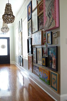 "We all are pretty familiar with the ""gallery wall"" but what about a full on ""gallery hall?"" This New Orleans home belongs to Kellie and Marc (my sister and brother-in-law) w…"