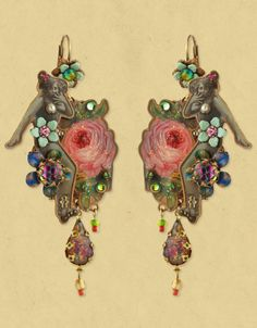 Beautiful handmade Michal Negrin earrings ornamented with swarovski crystals, glass beads and a falling drop shaped swarovski crystal that hangs beautifully. $180.00