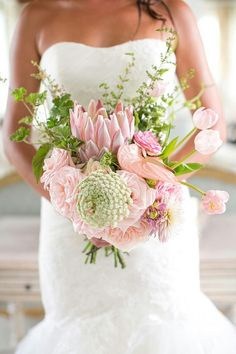 {Gorgeous & Exotic Bridal Bouquet With Pink Protea, Pink English Garden Roses, Pink Anthurium, Pink Tulips, White Queen Anne's Lace, Violet Dahlias & Mixed Green Foliage}
