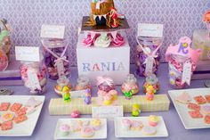 Pink and purple fairy princess party with candy bar.