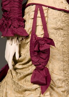 Victorian fashion detail: Reception dress, c. 1876 with close- up of burgundy purse matching the dress. more pins on original site.