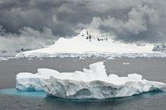 Mountain range covered by glaciers in the Wilhelmina Bay, iceberg in the foreground Wilhelmina Bay - Antarctic Peninsula www.daisygilardini.com