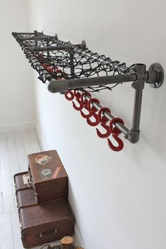 Industrial Steel Pipe Racks #DIYPipeProjects >> See us for more ideas at http://wiselygreen.com/15-industrial-pipe-furniture-and-home-projects-for-diyers/