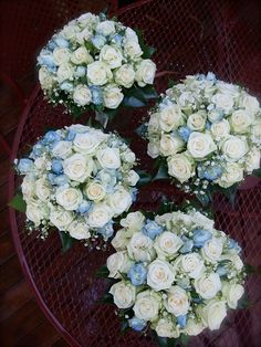Blue and white roses with baby's breath. Also Flickr doesn't let you pin anything, did you know that? What a jerk.