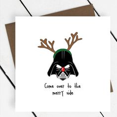 Be funny this christmas with this Star wars themed Darth Vader Christmas card from A Piece Of Ltd.This card can be sent directly to the recipient. If chosen the correct options, the card will then be neatly handwritten by us and sent in the envelope to the delivery address as you have provided at checkout. All our cards are printed in UK and comes with a high quality brown grainy envelope. Also please see 'more items from seller' for other illustrated greeting cards in A Piece Of's…