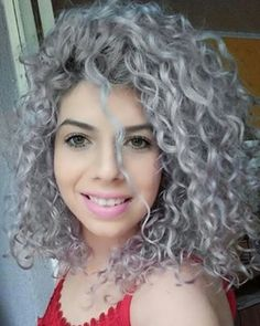 Thick, wavy, curly natural grey hair. I love the colour and texture ...