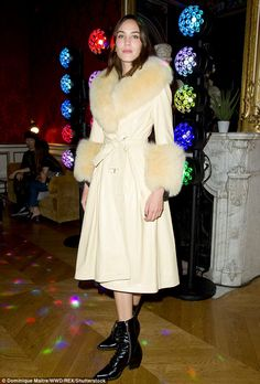 Style queen:Alexa Chung showcased her signature style as she wrapped up in a lemon fur co...