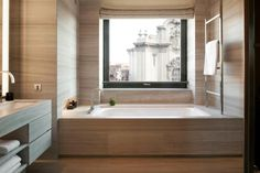 A chic and sleek guest bathroom at Armani Hotel Milan.