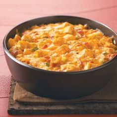 Texan Ranch Chicken Casserole    Ingredients  1 large onion, finely chopped  2 celery ribs, finely chopped  1 medium green pepper, finely chopped  1 medium sweet red pepper, finely chopped  1 tablespoon canola oil  1 garlic clove, minced  3 cups cubed cooked chicken breast  1 can (10-3/4 ounces) reduced-fat reduced-sodium condensed cream of celery