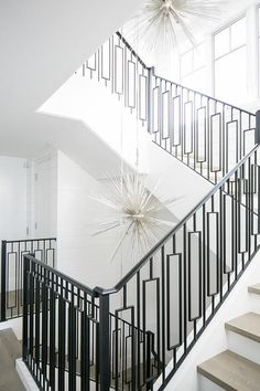 Modern Wrought Iron Staircase railing with Gray Stair Treads - Transitional - Entrance/foyer Iron Handrails, Wrought Iron Stair Railing, Staircase Railings, Iron Spindles, Staircases, Stair Treads, Railing Design, Staircase Design, White Staircase