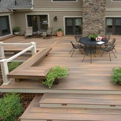 This deck remodel is so stunning! I love how the wood bench on the side is great for a border or just a place to sit. That part would make parties and events easier to hold because of the extra space. I also just love how roomy the deck is — you wouldn't have to worry much about overcrowding with a size that big. I hope that one day, we'll be able to do something like this in our backyard.