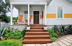 so cute...love that yellow stripe and blue ceiling porch!