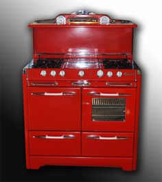 "1950's era O'Keefe and Merrit stove. It has the traditional stove top, a griddle (!!!) an oven, two warming drawers, and a ""Grillovator"" for easy broiling. OH, and it's red."