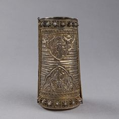 Indonesia ~ South Sulawesi    A Tall Armlet (Tigero Tedong); silver gilt   19th Century