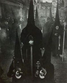 Its supposed to be witches but it looks like an inverted version of the kkk