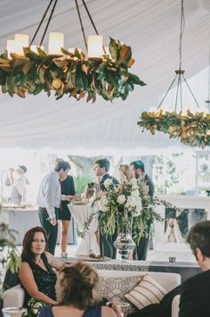Magnolia-leaf dressed chandeliers. Perfection! By Tiger Lily Weddings, Photo by Sean Money and Elizabeth Fay.