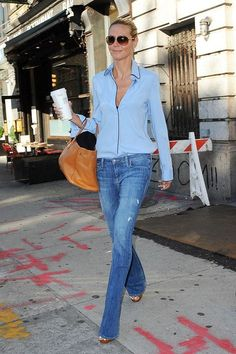 Heidi Klum pairs her denim duds with a pajama inspired button down.  Be inspired and shop here: http://rstyle.me/n/r4vj6bgbrf