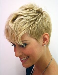 silky short hairstyle is blow-dried smooth to show off the layers cut ...