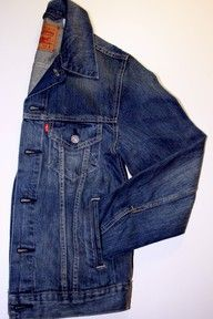 LEVI'S Jean Jacket with a sequinned mini skirt,a long formal silk skirt or a petticoat and cowboy boots.