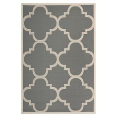Loomed indoor/outdoor rug with a gray and beige quatrefoil motif.   Product: RugConstruction Material: Polypropylene... 5x3 round $52.95