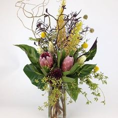 #happybirthday @_bbww_ Brent Wadden with multiple types of #protea, #eremurus, #anthurium leaves , naked seeded #eucalyptus, #kangaroopaw, #scabiosapods, #curlywillow and #beautiful #craspedia.  Almost forgot to mention the little cluster of #hensandchicks In the front - to bring you great fortune and success in fulfilling your dreams!!! hope you had a great day! And if you have any questions about the apology air plant  just give us a call!