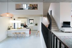 Informal Cube: Minimal Urban House in White with a Multi-Level Interior