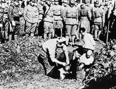 Chinese prisoners are buried alive by their Japanese captors outside the city of Nanjing.