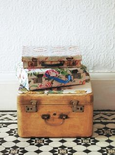 Fabric covered suitcases.