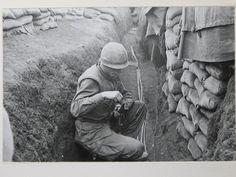 Photo of Marine cleaning his M-16 rifle on 2-24-1968 at the Siege of Khe Sanh. Photo courtesy of the National Archives. Photo by Sgt. J. S. Ryan, USMC. BRAVO! COMMON MEN, UNCOMMON VALOR @ https://bravotheproject.com/. #BRAVO! #USMC #KheSanh #VietnamWar
