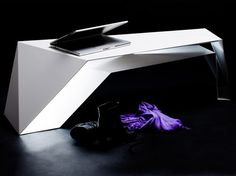 Italian firm Novae Architecture churns out a variety of design including both architecture and furniture, with their latest being the FOLDONE Table. The table appears to be a series of folds from one continuous piece of steel, which creates functional areas capable of storing your things.