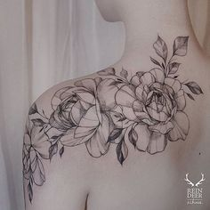 beautiful flower tattoo on the shoulder
