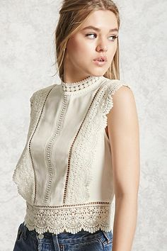 A semi-cropped woven top featuring a crochet trim, a mock neck, ladder cutout inserts, a sleeveless cut, and a button back. Sewing Clothes, Crochet Clothes, Crochet Dresses, Mode Ootd, Outfit Trends, Mode Inspiration, Lace Tops, Blouse Designs, Fashion Outfits