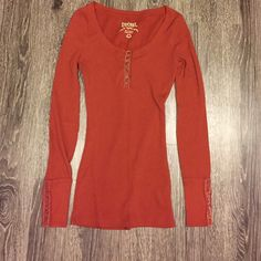Burnt orange thermal top Only worn once! Cute velvet details on the sleeves and the front. The pictures make it look sort of pumpkin orange, but it's really burnt orange. Decree Tops