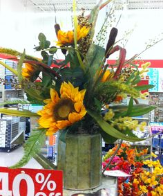 Fall arrangement of sunflowers and grasses in a watering can.    2014.  Laura A.    Michaels Tulsa (3864)