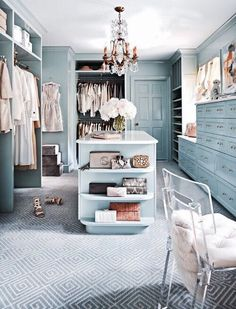 Walk in closet in a light blue color