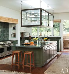 Architectural Digest image from Portia De Rossi and Ellen DeGeneres' Kitchen.  Check out the Glass display case for storing tableware- so cool.