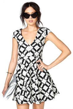 Make a statement in this absolutely amazing dress featuring a black, gray and white abstract prin...