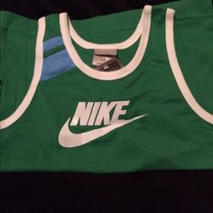 NWT Nike tank top Vintage feel green Nike tank top with white trim. Retro #72 on the back. Super cute tank looking for a new home. Comes from a smoke-free, pet-free home. Nike Tops Tank Tops