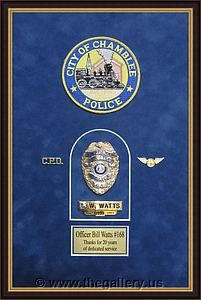 Police Department retirement shadow box with police badges, patches, ID cards and lapel pins.  The Gallery at Brookwood www.thegallery.us 770-941-3394 Your Custom Framing Expert