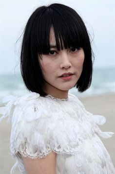 Rinko Kikuchi as Hinata, a reporter who works on a Weekly World News-style publication. Then she finds out that the creatures they write jokingly about are real...